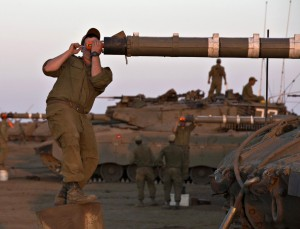 An Israeli soldier adjusts sights on a tank during a drill in the Golan Heights on Thursday. (REUTERS/Baz Ratner)