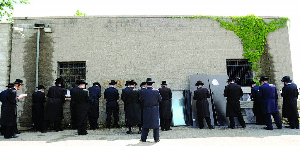 """Thousands of people went to the beis hachaim in Kiryas Yoel on Friday to mark the 34th yahrtzeit of Harav Yoel Teitelbaum, the Satmar Rebbe, zt""""l. (AP Photo/Times Herald-Record, Chet Gordon)"""
