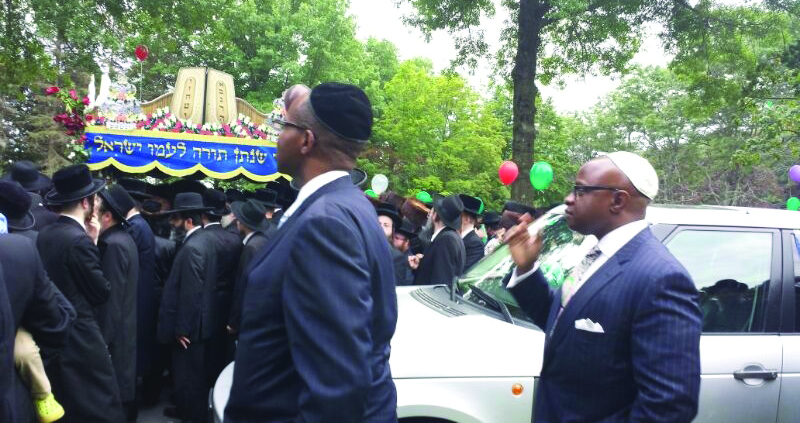 Brooklyn district attorney candidate Kenneth Thompson, who is campaigning for the Sept. 10 Democratic primary, attends a hachnasas sefer Torah at the Krule camp in the Catskills on Sunday.