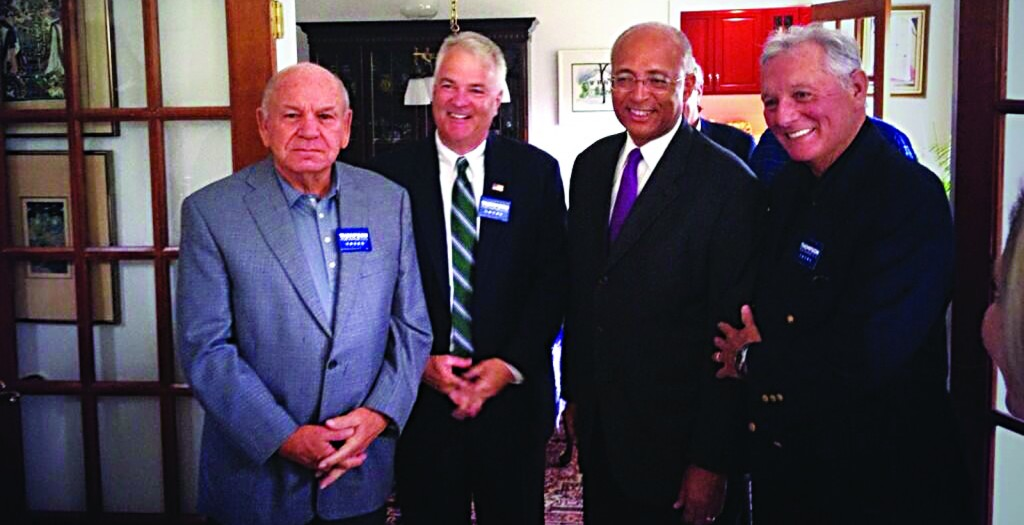 Bill Thompson (second right) meeting with business owners in Staten Island Thursday, as he begins a 5-borough tour that ends on Friday morning.