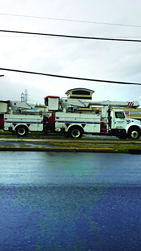 Utility vans work to restore power in Lakewood, N.J. Tuesday morning as the lights went out in hundreds of homes across the area. (News Breakers)