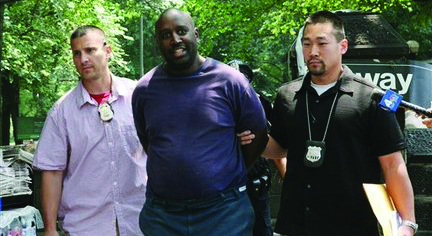 Darius McCollum is arrested in 2008 after police say he impersonated a New York City transit worker. (AP Photo)