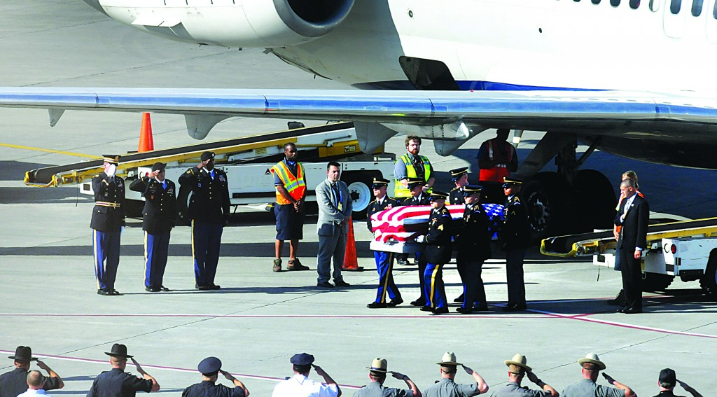 The remains of Sgt. Dominick J. Licari (inset) arrive at Albany International Airport on Friday afternoon. (AP Photo/The Albany Times Union, Michael P. Farrell)