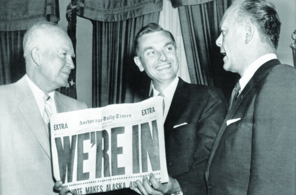 Governor Mike Stepovich of Alaska holding a copy of the Anchorage Daily Times trumpeting the passage of the Alaskan statehood bill. He is standing between President Eisenhower and Secretary of the Interior Frederick Seaton.(Elmer E. Rasmuson Library, University of Alaska Fairbanks)