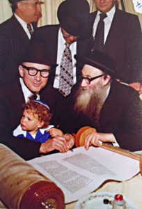 Completion of sefer Torah he had written for his parents and in-laws after Holocaust. Grandson on his lap.