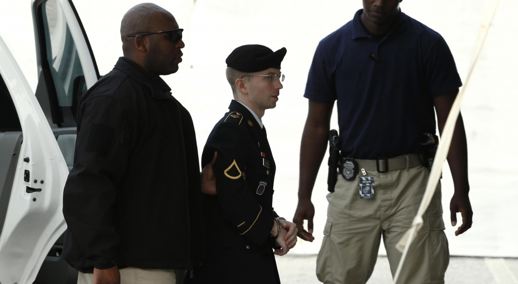 U.S. soldier Bradley Manning is escorted into court to receive his sentence at Fort Meade in Maryland, Wednesday. (REUTERS/Kevin Lamarque)