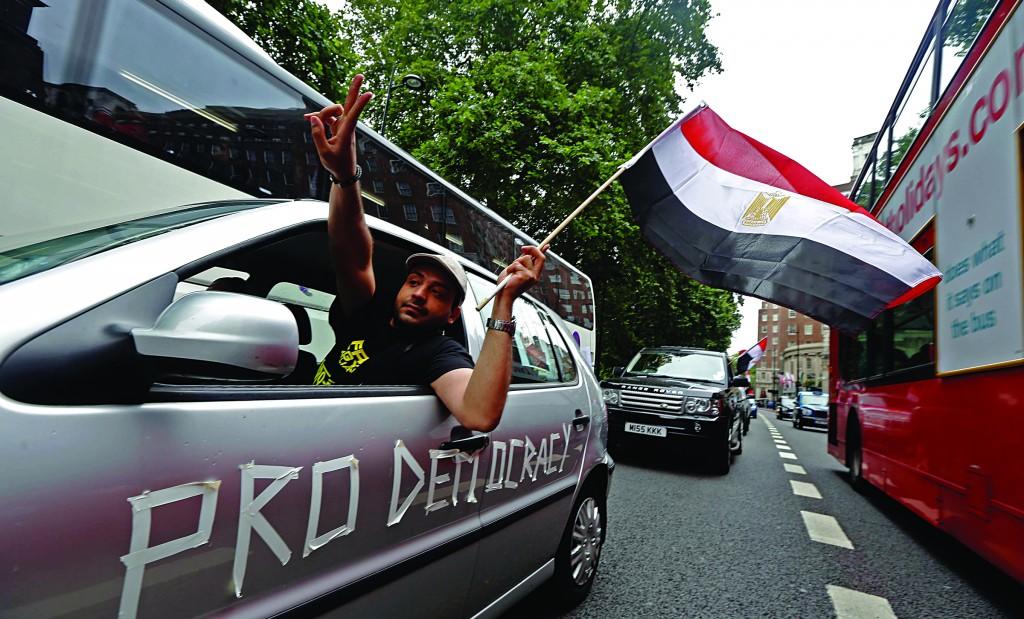 Supporters of deposed President Mohammed Morsi demonstrate as they drive slowly through central London. (REUTERS/Luke MacGregor)