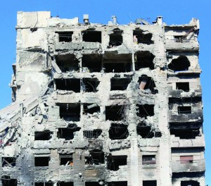 A damaged building is seen in Jobar, Damascus on Sunday.(REUTERS/ Mohamed Abdullah)