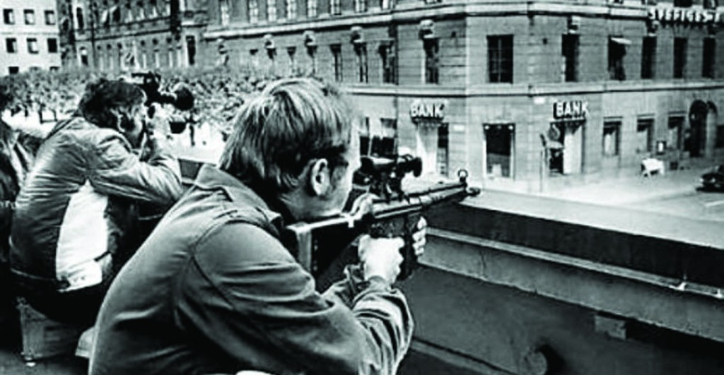 Swedish authorities watching over the hostage situation in Stockholm during a 1973 a bank robbery