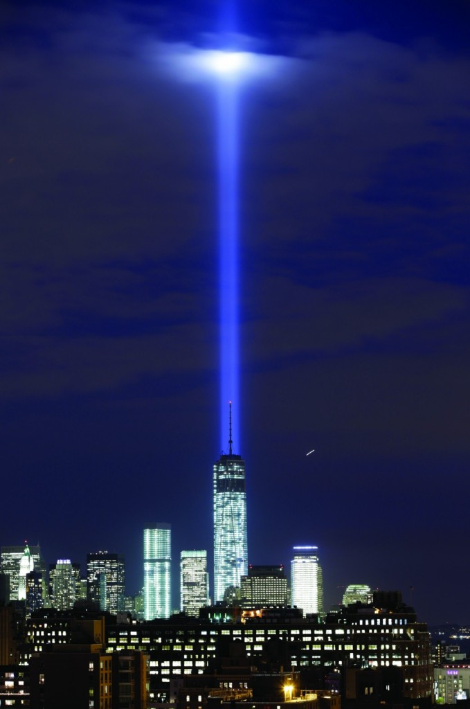 A test of the twin beams of the Tribute in Light intersect with still-under-construction Tower One as they rise behind the building and above lower Manhattan, Monday, Sept. 9, in New York. (AP Photo/Kathy Willens)