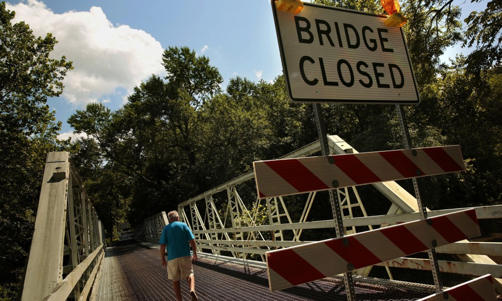 David Wisler walks across the bridge on Bergeys Mill Road, near his home in Schwenksville, Pa. Due to deterioration, the bridge was closed to auto traffic and Wisler must drive many miles out of the way to cross the river. (Carolyn Cole/Los Angeles Times/MCT)