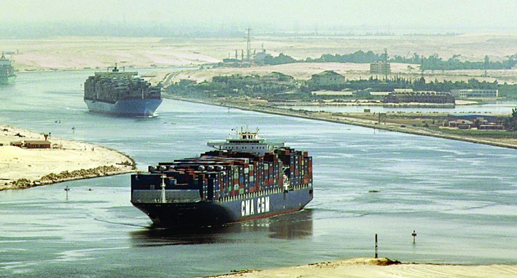 Cargo ships sail through the Suez Canal, seen from a helicopter, near Ismailia, Egypt. (AP Photo, File)