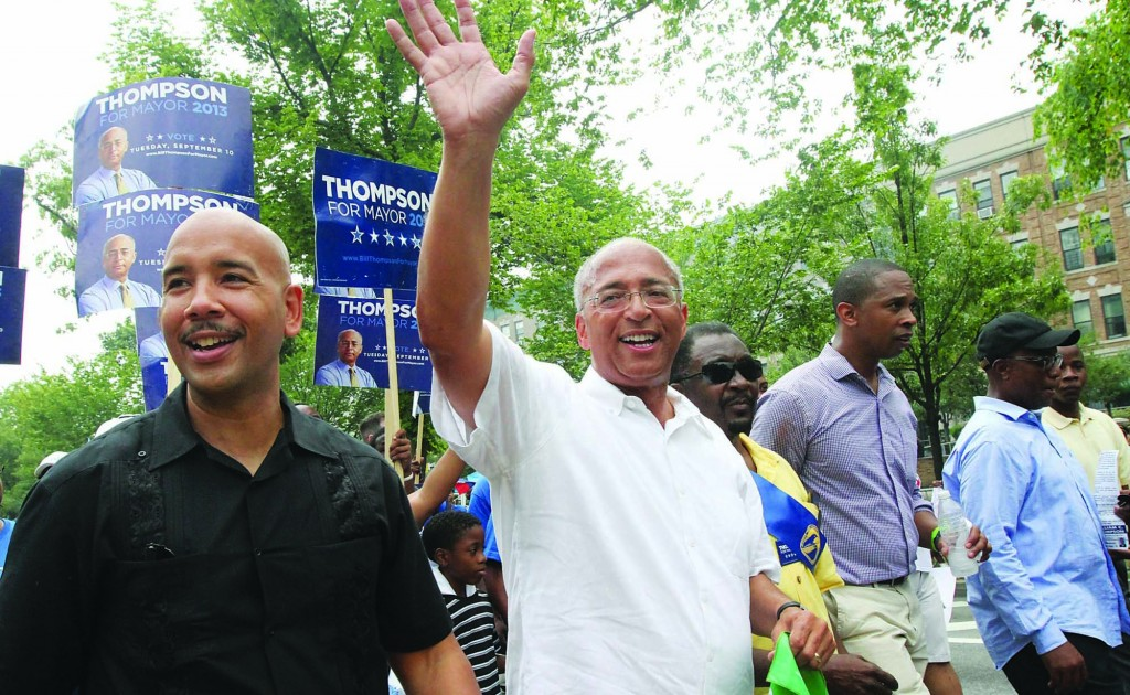 Bill Thompson, running in the NYC Mayor's race (foreground, second from left) waves as he makes his way along Eastern Parkway in the Brooklyn borough of New York during the West Indian Day Parade, Monday. (AP Photo/Tina Fineberg)