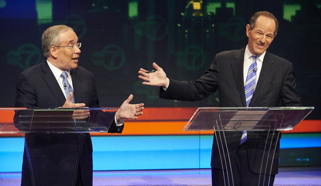Manhattan borough president Scott Stringer (L) and former New York Gov. Eliot Spitzer, both Democrats, participate in the first primary debate for New York City comptroller in New York this past summer. (AP Photo/New York Daily News, James Keivom, Pool, File)