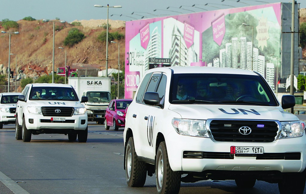 The convoy of a U.N. team of weapons inspectors, who concluded its almost week-long mission in Syria, arrive at Rafik Hariri international airport in Beirut, Lebanon, Monday. (AP Photo/Bilal Hussein)