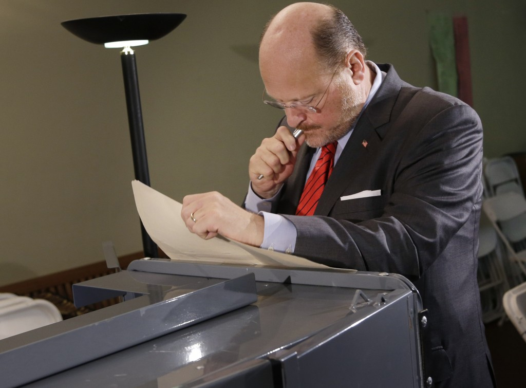 Republican mayoral hopeful Joe Lhota fills out a paper ballot at his polling station during the primary election in New York, Tuesday. The voting machines were not functioning. (AP Photo/Seth Wenig)
