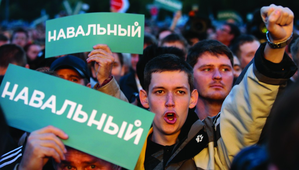 Supporters of Russian opposition leader Alexei Navalny attend a rally in Moscow, Monday. (REUTERS/Tatyana Makeyeva)