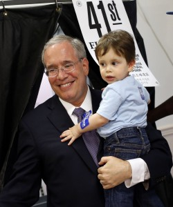 Manhattan Borough President Scott Stringer emerges from a voting booth with his 20-month-old son Max after casting his ballot during the primary election, Tuesday. (APPhoto/Jason DeCrow)