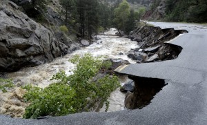 Lefthand Canyon Road near the intersection of Olde Stage Road in Boulder, Colo., on Saturday in Boulder. (AP Photo/Daily Camera, Jeremy Papasso)