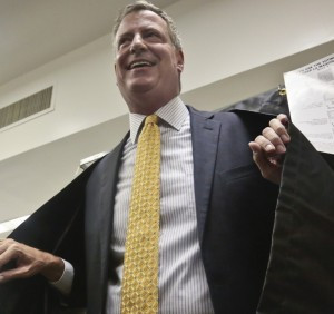 Mayoral candidate Bill de Blasio leaves a voting booth after casting his primary vote on Tuesday, at the Park Slope Public Library in Brooklyn, N.Y. (AP Photo/Bebeto Matthews)