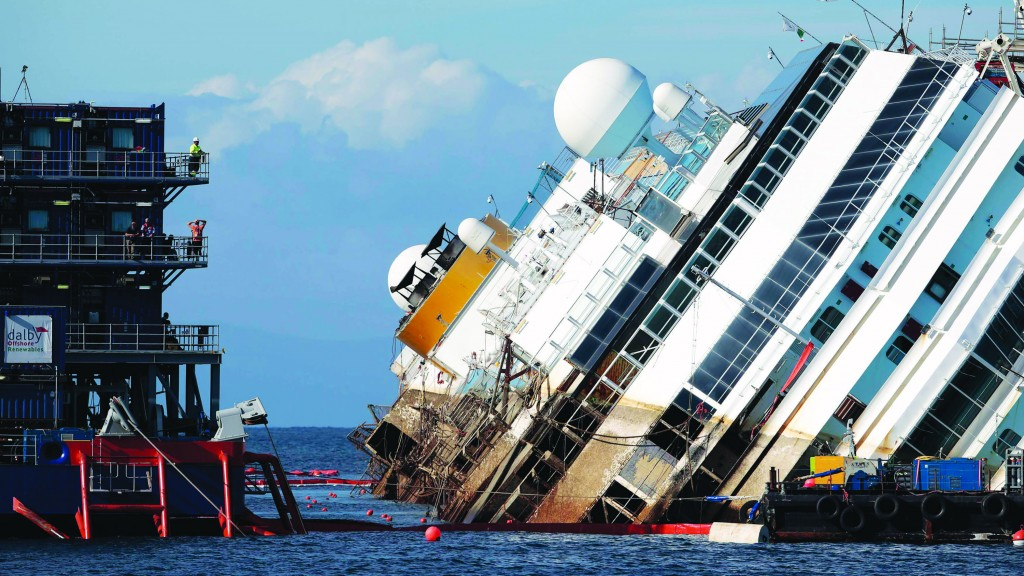 Salvage crew looks at the capsized cruise liner Costa Concordia during the operation, outside Giglio harbor Monday. (REUTERS/Tony Gentile)