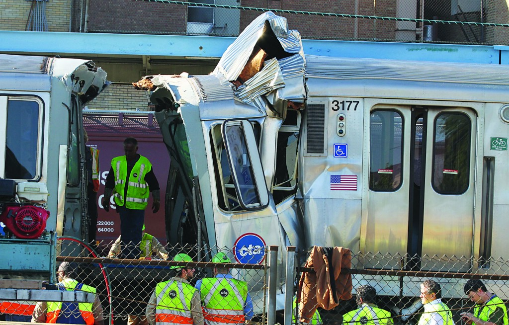 Emergency personnel investigate the scene where an empty Chicago Transit Authority train traveling eastbound hit a westbound train that was carrying passengers and had stopped in Forest Park, Illinois, Monday morning, about 10 miles west of downtown Chicago. As many as four dozen people were injured, though none of the injuries appeared to be life-threatening, officials said.   (Chuck Berman/ Chicago Tribune/MCT)