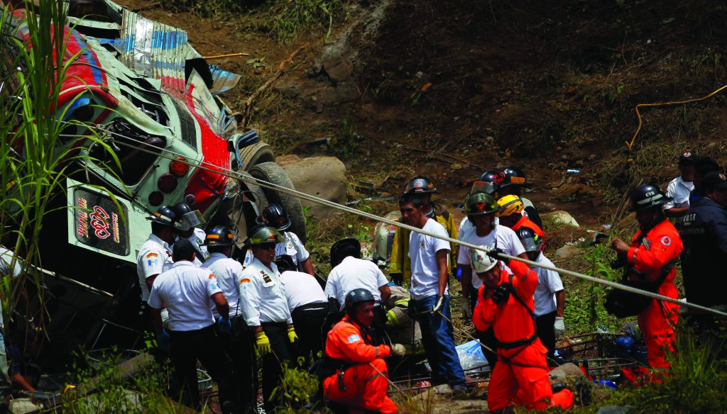 Rescuers stand near the bus crash site in San Martin Jilotepeque, Chimaltenango region Monday. (REUTERS/Jorge Dan Lopez)
