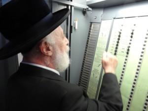 The Liska Rebbe, Harav Tzvi Hersh Friedlander, votes at a polling station in Boro Park.