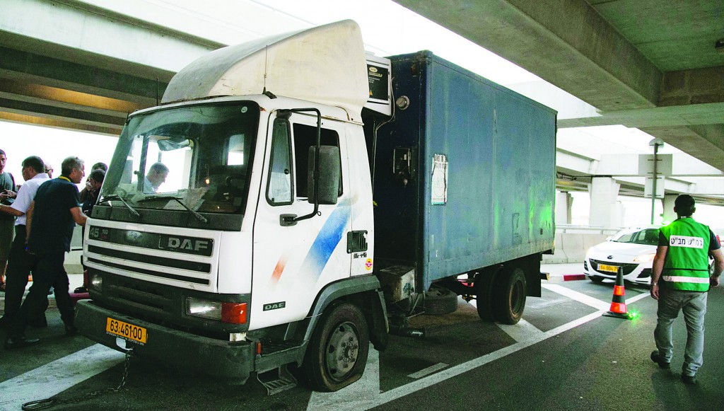 The truck stolen by Palestinian men that was driven through Ben Gurion Airport's security barrier early Monday morning. (FLASH90)