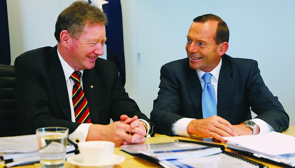 Australia's conservative leader and Prime Minister-elect Tony Abbott (R) meets the Secretary of the Department of the Prime Minister and Cabinet Ian Watt, in Sydney after Abbott was victorious in national elections September 7. (REUTERS/Daniel Munoz)