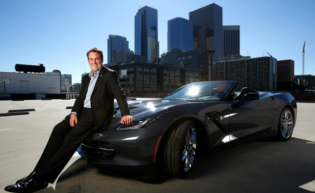 Mark Reuss, president of General Motors, is photographed in downtown Los Angeles, August 28, 2013, next to the company's new 2014 Corvette Stingray convertible. (Mel Melcon/Los Angeles Times/MCT)