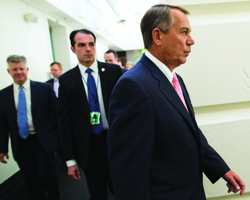 House Speaker John Boehner of Ohio walks to a House Republican Conference meeting to discuss the ongoing budget fight, Monday, on Capitol Hill in Washington.  (AP Photo/ Evan Vucci)