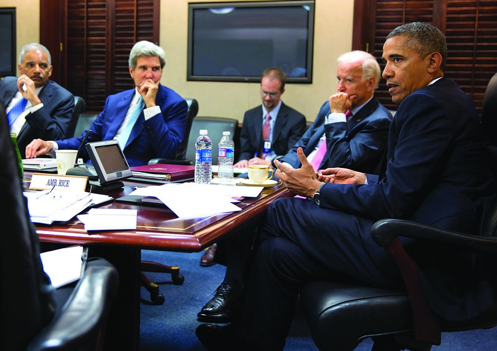 President Obama meets with his national security staff in the Situation Room of the White House, Friday.