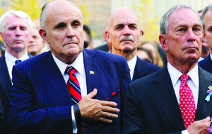 Former New York Mayor Rudolph Giuliani (foreground, L) and Mayor Michael Bloomberg attend ceremonies at the 9/11 Memorial marking the 12th Anniversary of the attacks on the World Trade Center, in New York, Wednesday (AP Photo/The Daily News, David Handschuh, Pool)