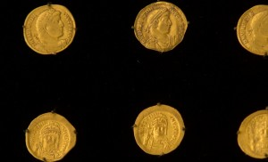 Ancient coins are shown during a press conference in Yerushalayim on Monday. (AP Photo/Sebastian Scheiner)
