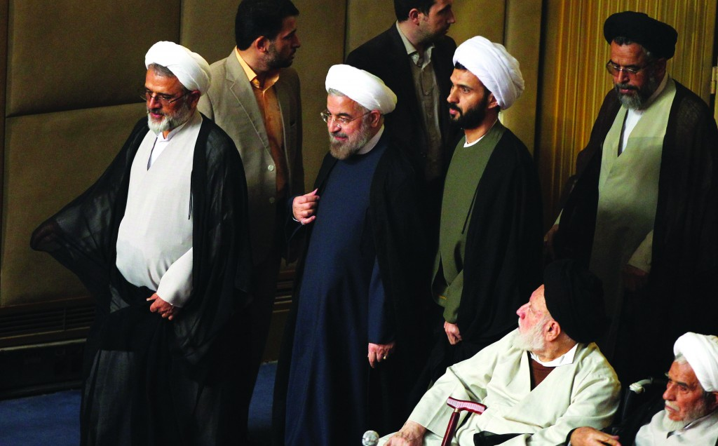 Iranian President Hasan Rouhani, center, attends a session of the Assembly of Experts in Tehran Tuesday. (AP Photo)