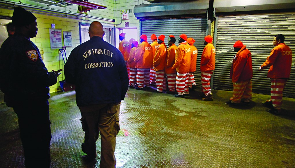 Inmates file out of the prison bakery at the Rikers Island jail after working the morning shift in this file photo. (AP Photo/Bebeto Matthews)