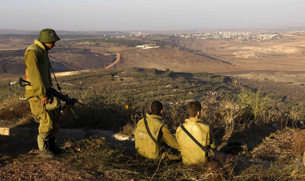 Israeli soldiers in the Golan Heights near the Syrian border (REUTERS/Ronen Zvulun)