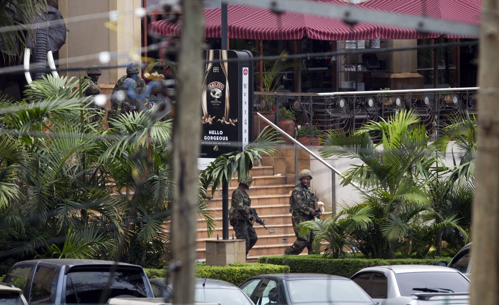 Soldiers from the Kenya Defense Forces walk out, following the sound of explosions and gunfire, from the Westgate Mall in Nairobi, Kenya Sunday. (AP Photo/Ben Curtis)