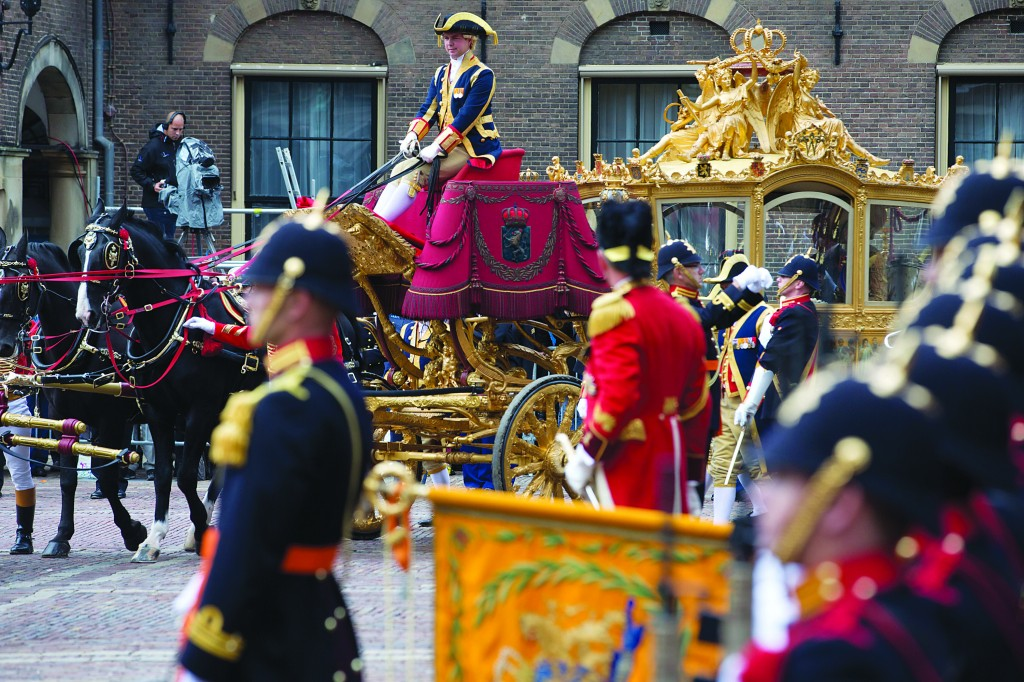 Netherlands' King Willem-Alexander arrives in a Golden Carriage at the Hall of Knights for the official opening of the new parliamentary year Tuesday. (AP Photo/Peter Dejong)