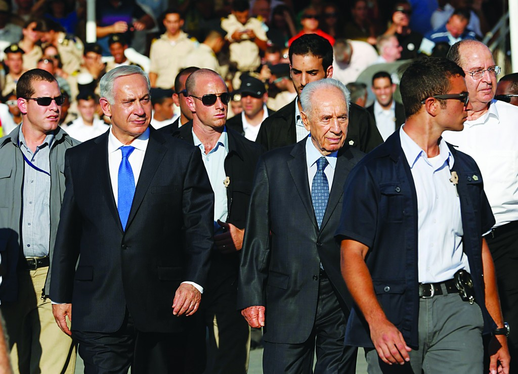Israel's President Shimon Peres (3rd R) and Prime Minister Binyamin Netanyahu (3rd L) arrive at a graduation ceremony of Israeli naval officers in Haifa, where Netanyahu said on Syria must be stripped of its chemical weapons. (REUTERS/Baz Ratner)