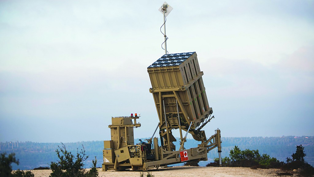 An Israeli soldier by an Iron Dome battery near Yerushalayim on Monday. Israeli officials downplayed the deployment as routine. (Flash90)