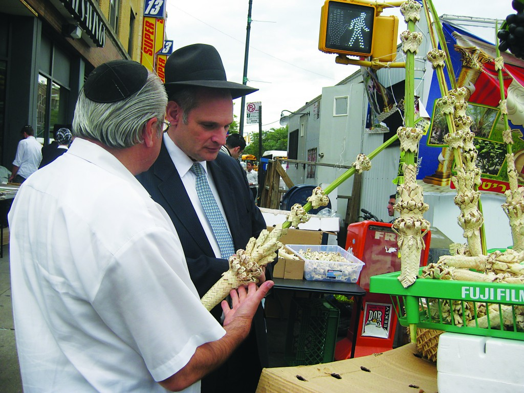 Yidden prepare for Sukkos in Boro Park, Tuesday. (SZ Greenberg)