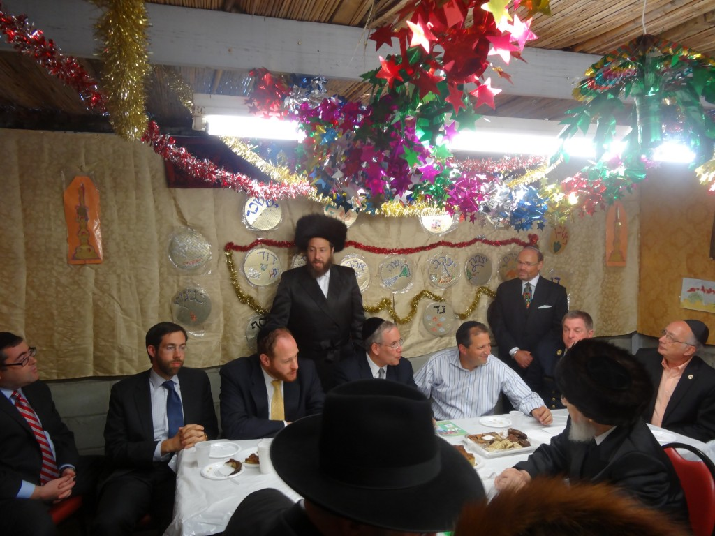 (L-R) State Sen. Daniel Squadron, Councilman David Greenfield, Manhattan Borough President (and Democratic candidate for city comptroller) Scott Stringer and Councilman Brad Lander at Ezra Friedlander's sukkah on Monday.
