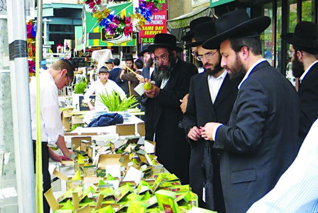 A vendor on Boro Park's 13th Avenue sells esrogim on Tuesday, the day before Erev Sukkos. (SZ Greenberg)