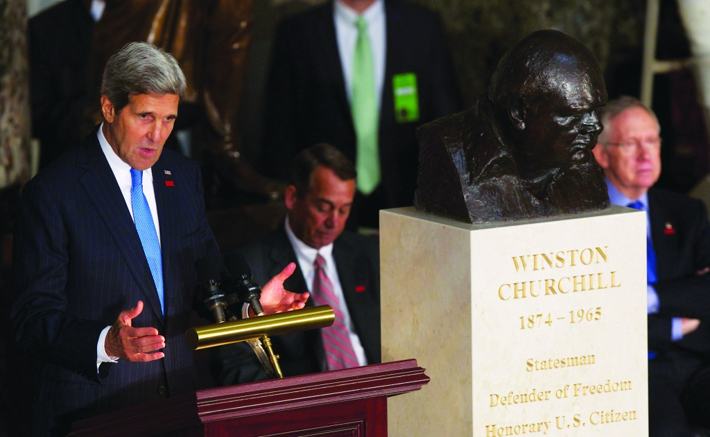 Secretary of State John Kerry (L) speaks in Statuary Hall on Capitol Hill in Washington on Wednesday during a ceremony to dedicate a bust of Winston Churchill. To Kerry's right are House Speaker John Boehner of Ohio and Senate Majority Leader Harry Reid of Nevada. (AP Photo/Molly Riley)