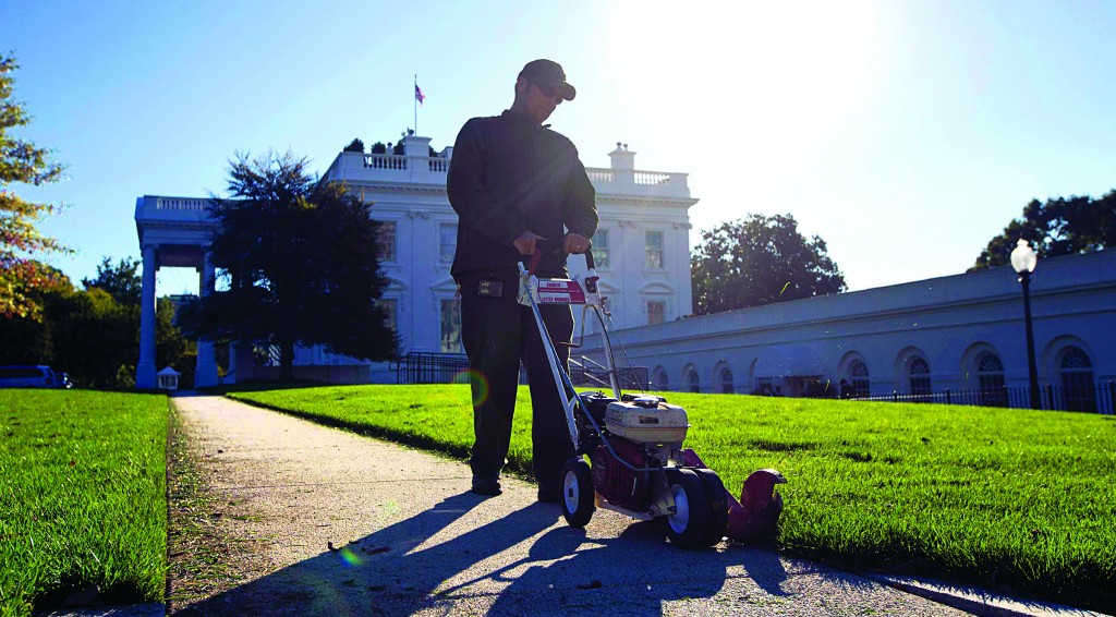 A National Park Service worker uses an edge trimmer on the White House North Lawn for the first time since the end of the U.S. Government shutdown in Washington, Friday. (REUTERS/Jason Reed)