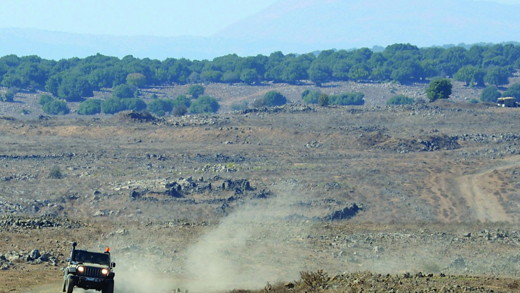 An Israeli army vehicle patrolling on the Golan Heights near the border with Syria. (Gili Yaari/Flash 90)