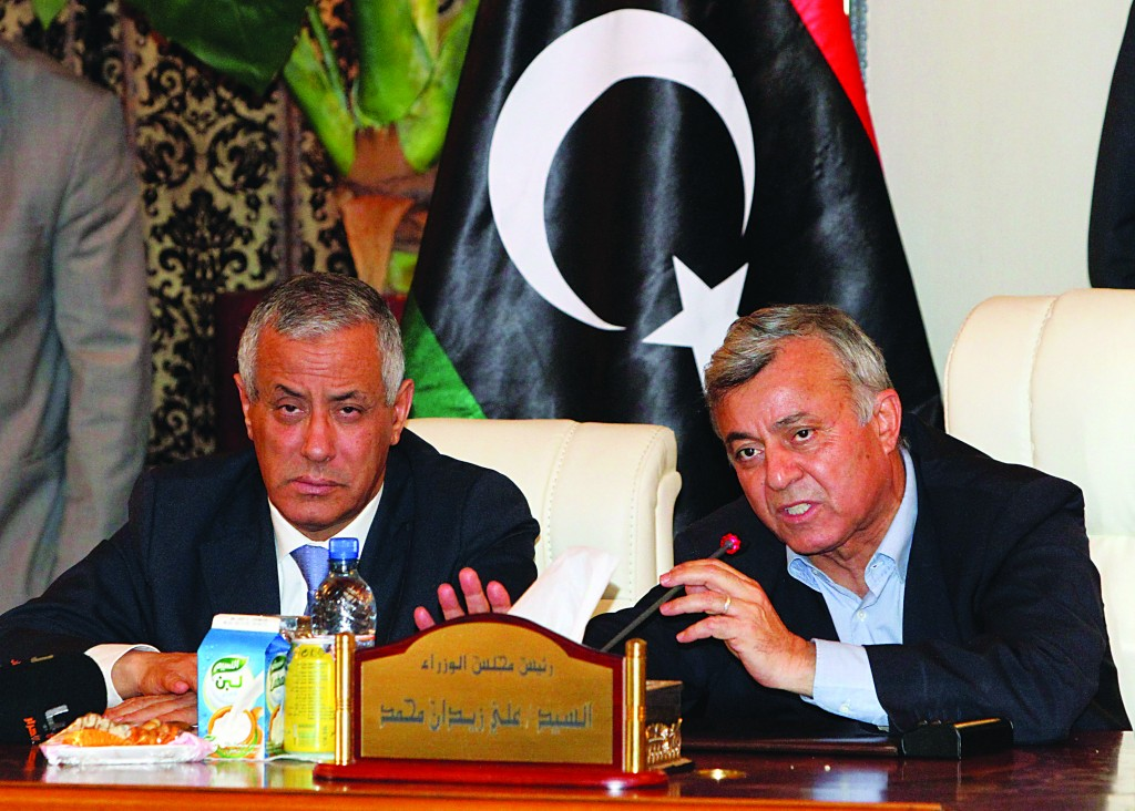 Libyan Prime Minister Ali Zidan (L) gives a press conference after being rescued from gunmen who snatched him from his hotel early Thursday and held him for several hours, in Tripoli Libya, Thursday. (AP Photo)