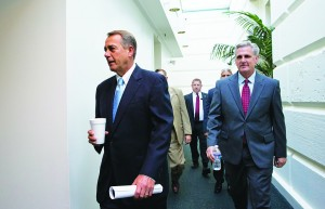 Speaker of the House John Boehne, (R-Ohio), with House Majority Whip Kevin McCarthy (R-Calif.), right, walks to a meeting of House Republicans at the Capitol in Washington, Tuesday, (AP Photo/J. Scott Applewhite)